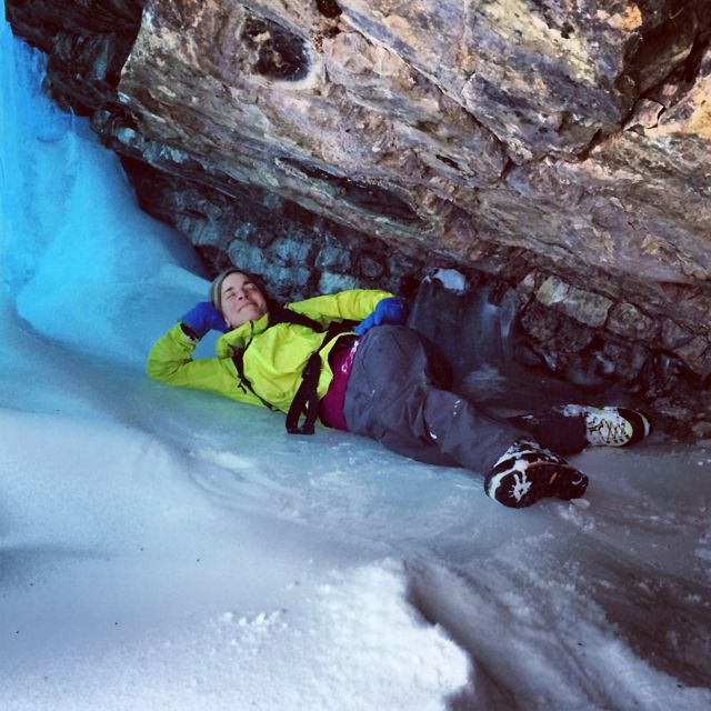 Yours truly, chilling (quite literally) in a cave before a climb in the Canadian Rockies.